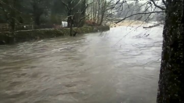 Disastrous flooding forces river onto land