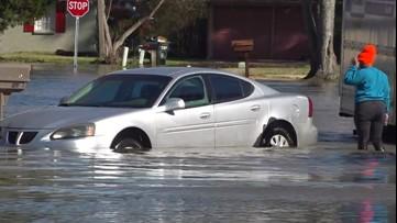 Woman stuck in flood water