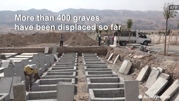 Hundreds of graves moved as town prepares to be flooded