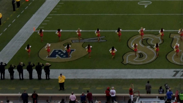49ers cheerleader kneels