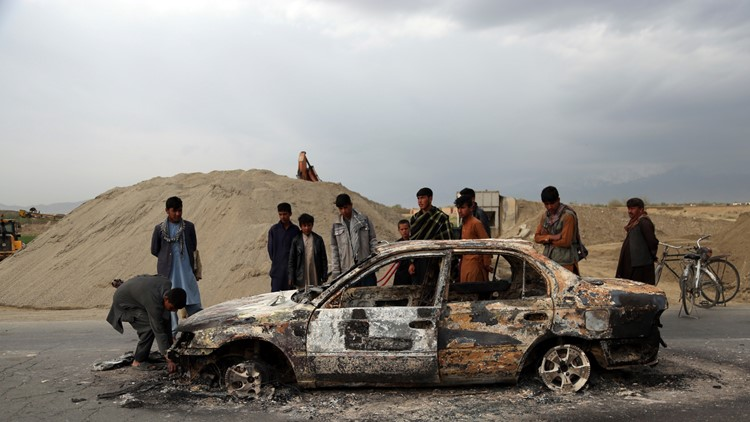 Afghanistan civilian vehicle burnt after attack near base April 2019