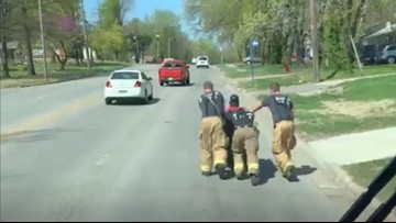 These firefighters pushed a veteran home when his electric wheelchair died
