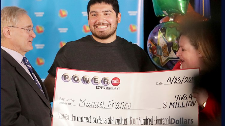Manuel Franco Powerball Lottery Winner accepting check