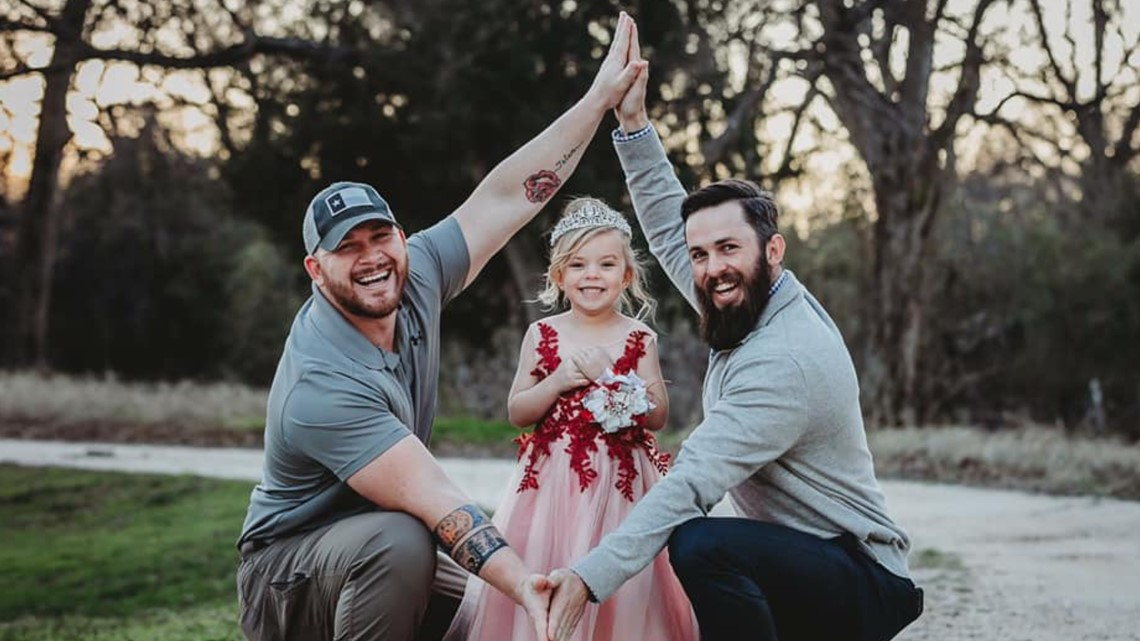 Photographs of 2 Texas fathers and their daughter goes viral
