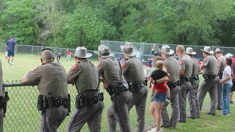 Troopers line up to cheer on son of injured coworker at baseball game in Texas