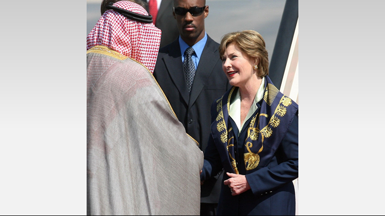 Saudi Prince Faisal bin Abdullah bin Abdul Aziz al-Saud greets US First Lady Laura Bush upon her arrival in Riyadh, 23 October 2007. (Photo: HASSAN AMMAR/AFP/Getty Images)