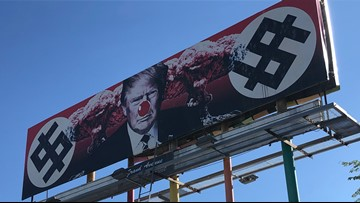 Video shows man adding red nose to controversial anti-Trump billboard