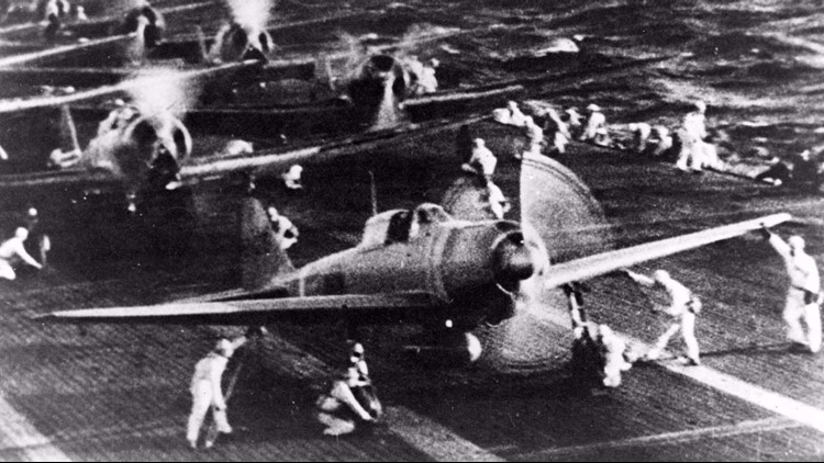 Japanese naval aircraft prepare to take off from an aircraft carrier (reportedly Shokaku) to attack Pearl Harbor during the morning of 7 December 1941. Plane in the foreground is a Zero Fighter. This is probably the launch of the second attack wave.