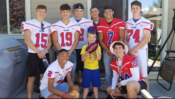 Football team goes to boy's birthday party after finding out he didn't have many friends coming