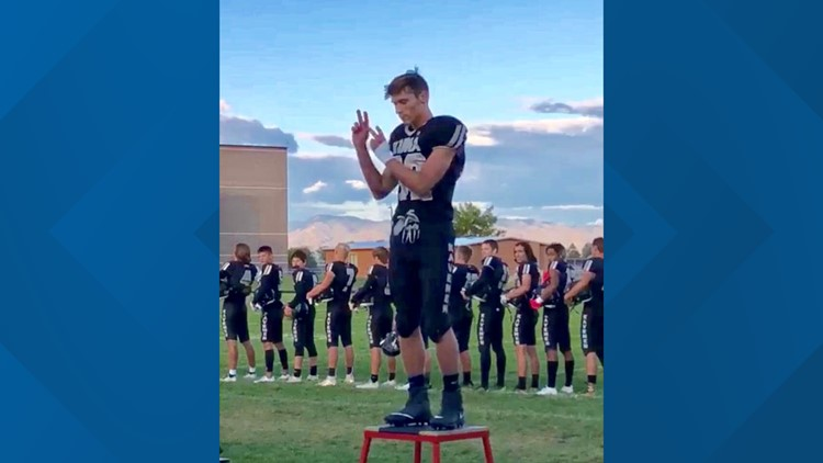 High School football player signs the national anthem at home game, and the video goes viral