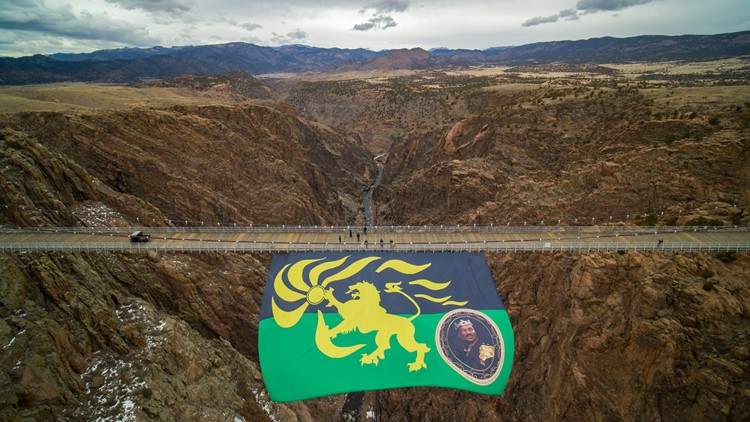 Huge Zamundan flag flown from Colorado suspension bridge