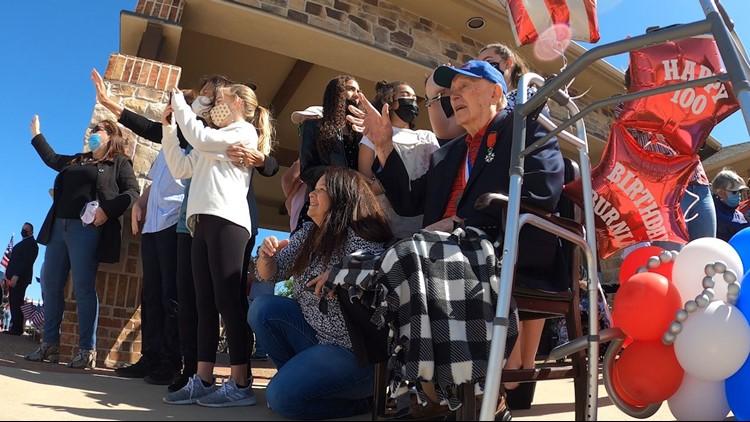 WWII hero celebrates 100th birthday, community throws 100-car parade