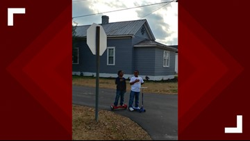 'It really touched my heart': Firefighter reacts to photo of boys saying pledge during flag raising at fire station