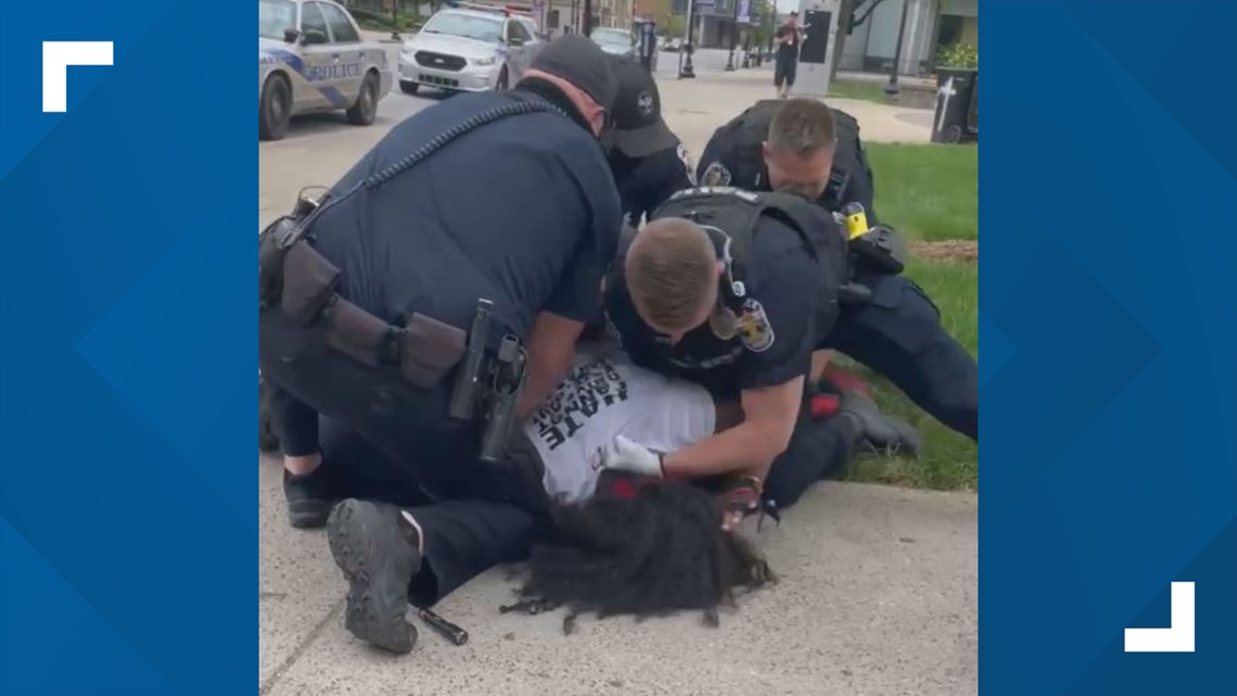 Louisville police officer under investigation after video appears to show him repeatedly punching man during arrest