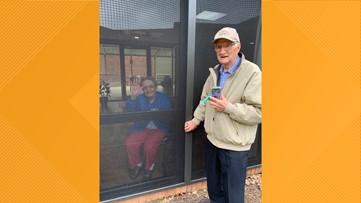 Love found a way: Couple celebrates 71st anniversary through nursing home window