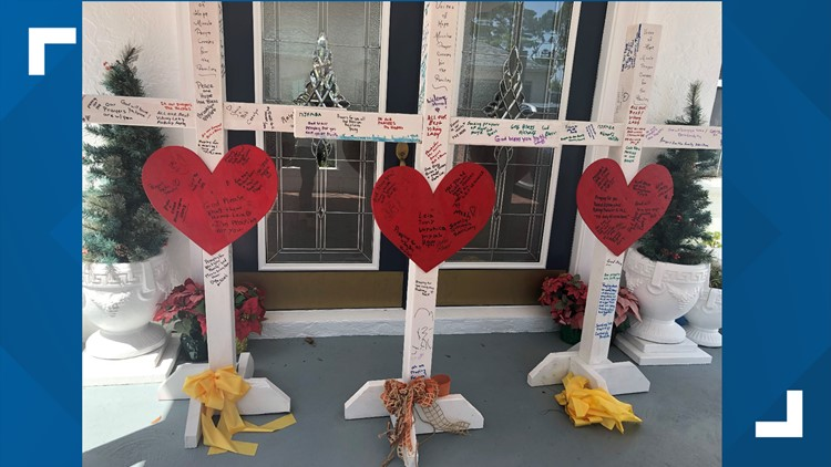 Crosses left at a memorial for Brian McCluney and Justin Walker