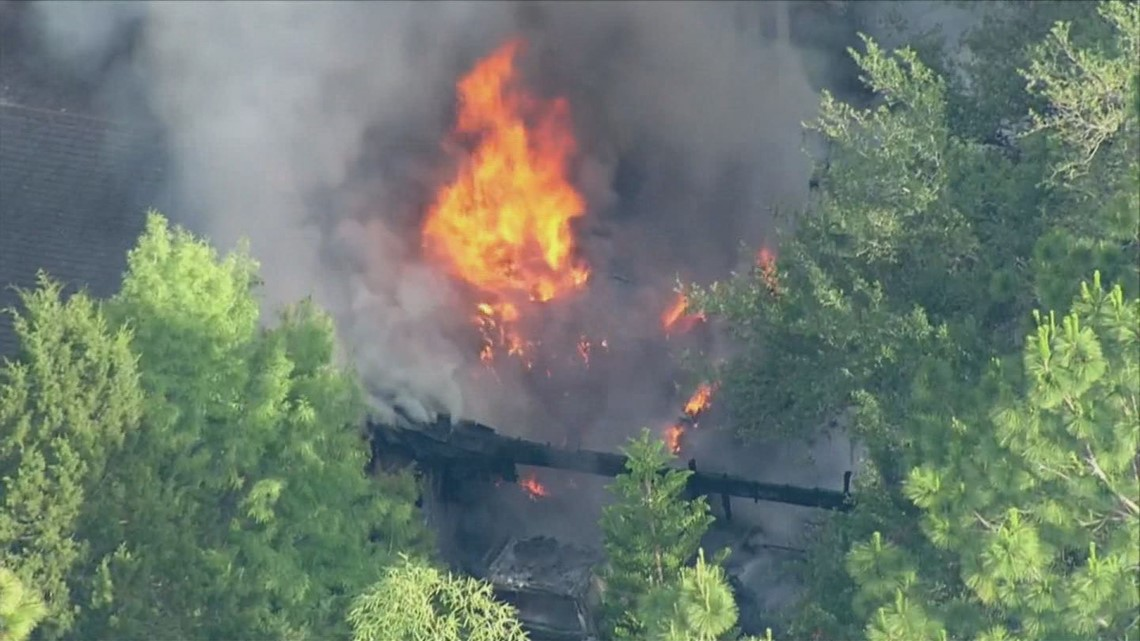 Sickles High School evacuated as crews battle nearby house fire