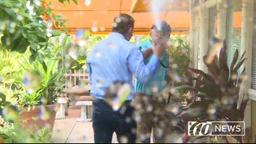 Video shows restaurant owner spray 10News reporter Beau Zimmer with a hose