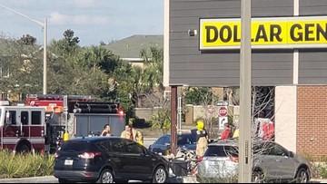 Car slams into dollar store