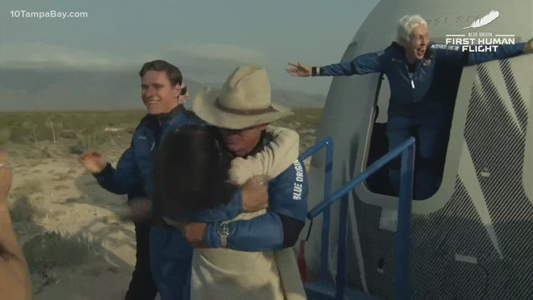 Jeff Bezos and Blue Origin crew emerge from capsule