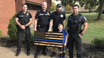 Wooden 'thin blue line' flag gifted to police won't be on display