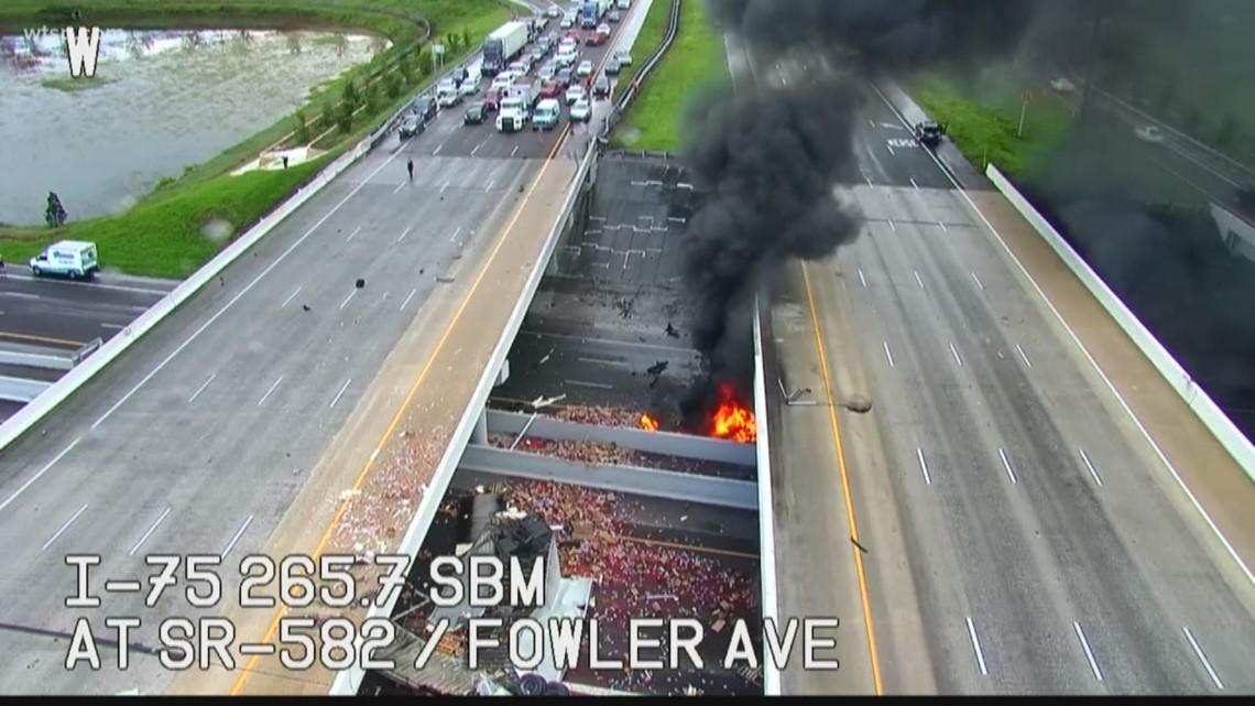 Semi crashes off I-75 onto Fowler