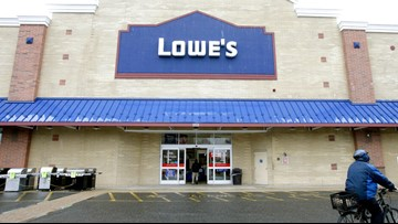 As Lowe's cuts thousands of workers, it buys back its stock