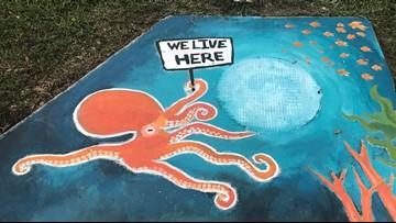 Storm drains has an artful message