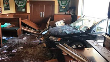 Six people injured after vehicle plows into restaurant
