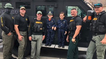 6-year old saved by first responders on Halloween gets special SWAT visit