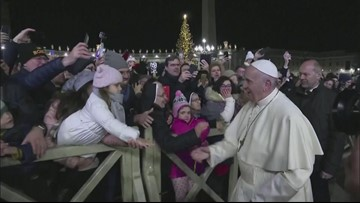 Pope slaps woman's hand after she yanks his arm