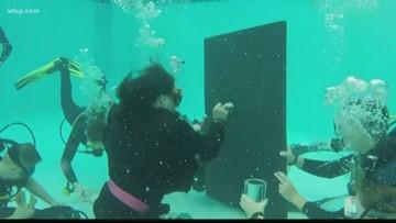 Underwater speed painting raises money for Admiral Farragut Academy