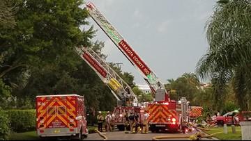 4-alarm fire still active in Sarasota County neighborhood