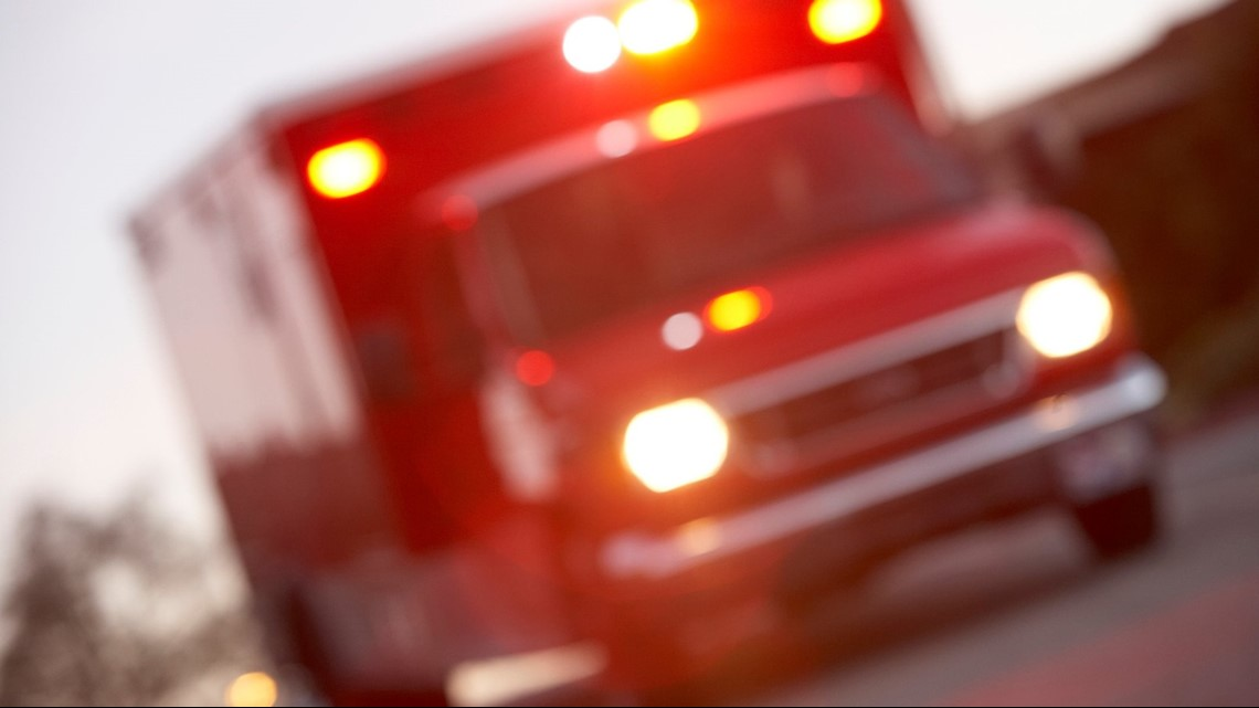 Car runs red light, crashes into ambulance in Tampa