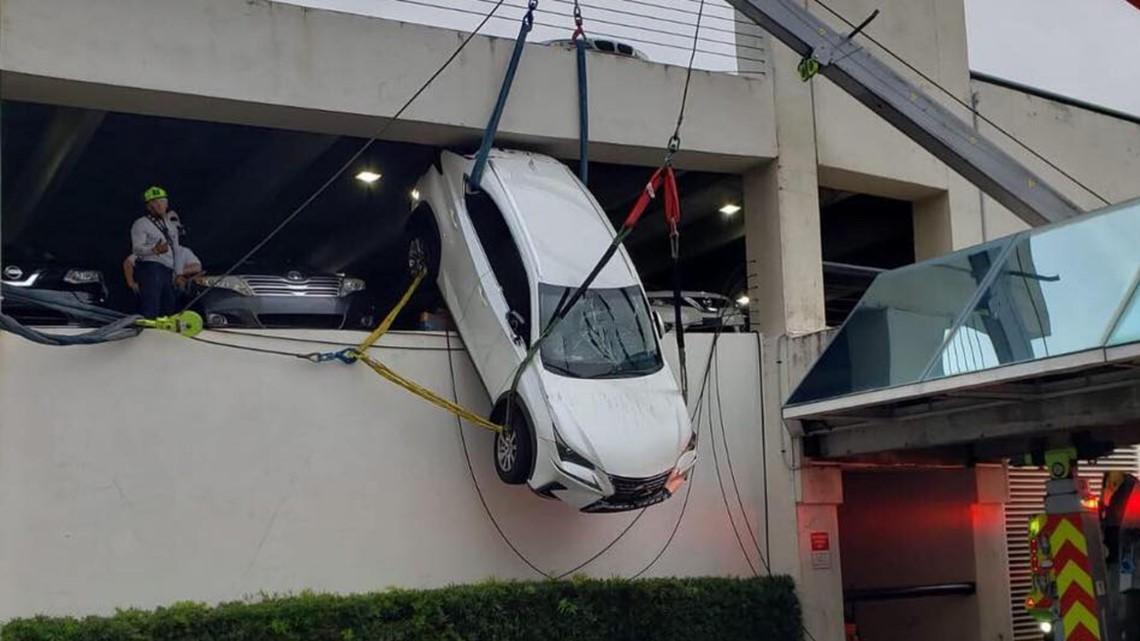 Woman Rescued After Car Found Dangling From 2 Story