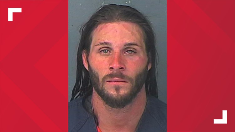 Deputies: Man rams truck into crowd outside bar, passerby intervenes to stop him