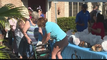 Local law firm gives out 500 free Easter hams to those in need