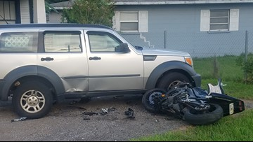 Motorcyclist killed after crash into parked SUV
