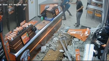 Video: Car plows through front of Florida Little Caesars