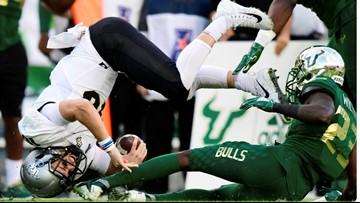 UCF quarterback McKenzie Milton suffers severe leg injury in game against USF