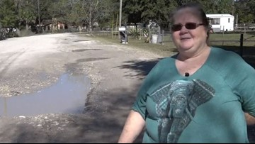 Pasco County residents asking county for help paving private road