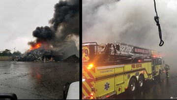 Overcast skies make it hard for crews to battle recycling yard fire