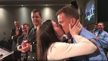 Firefighter proposes to girlfriend as she puts on his badge at graduation