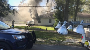 Fire erupts after car crashes into building in Dade City