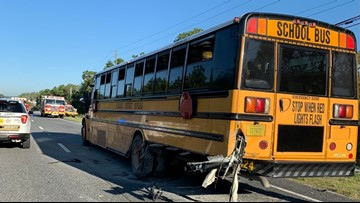 Car crashes into school bus picking up middle school students, officials say