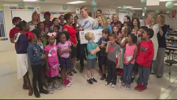 Duke Energy Florida presents check to Tampa Heights Elementary Magnet