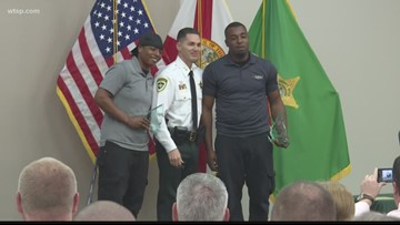 2 Good Samaritans honored for saving a child, family from sinking car