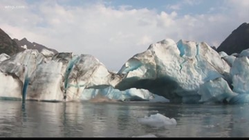 Kayakers get too close to breaking glacier