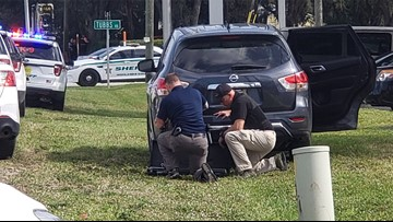 As gunshots rang out, an employee managed to escape the deadly Sebring bank shooting