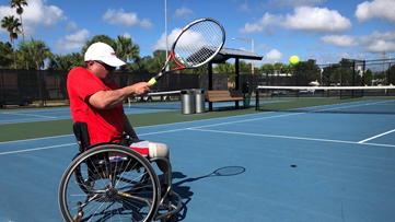 Wounded Warrior's love for tennis remains even from wheelchair